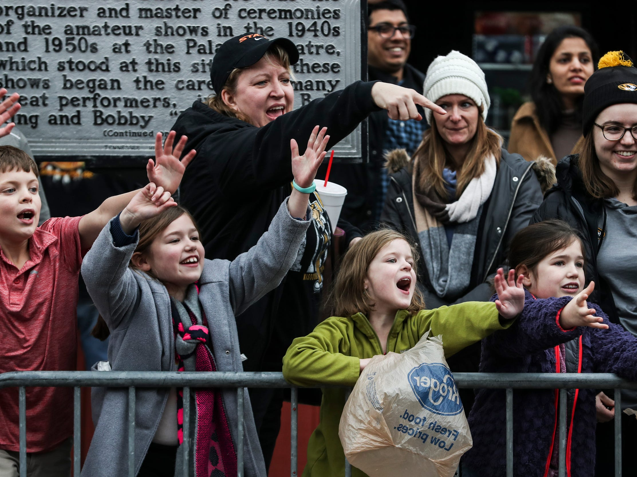 December 30 2018 - Kids reach out to catch candy during the Annual Liberty Bowl Parade & Pep Rally on Sunday. On Monday Oklahoma State Cowboys and Missouri Tigers play in the 2018 AutoZone Liberty Bowl.