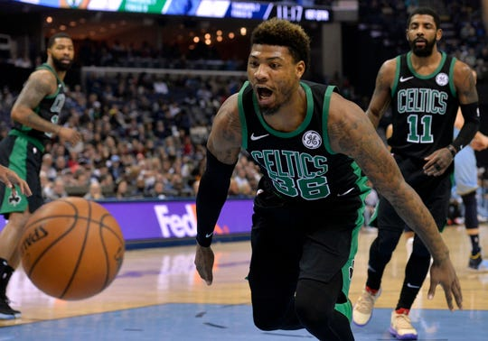 Boston Celtics guard Marcus Smart (36) watches as the bounces out of bounds during the first half of the team's NBA basketball game against the Memphis Grizzlies on Saturday, Dec. 29, 2018, in Memphis, Tenn. (AP Photo/Brandon Dill)