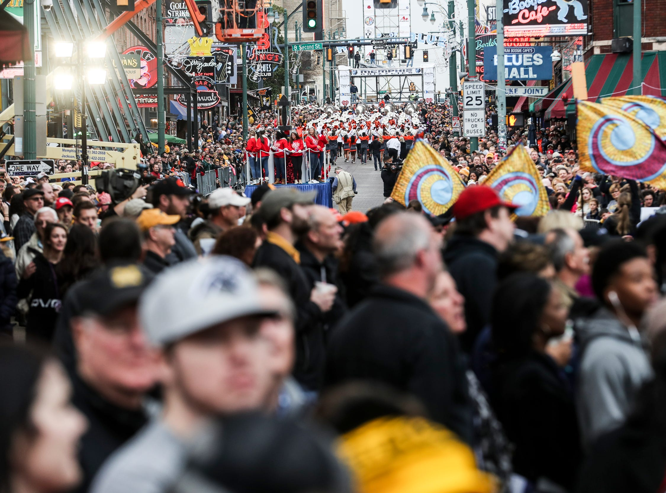 December 30 2018 - A view west along Beale Street during the Annual Liberty Bowl Parade & Pep Rally on Sunday. On Monday Oklahoma State Cowboys and Missouri Tigers play in the 2018 AutoZone Liberty Bowl.