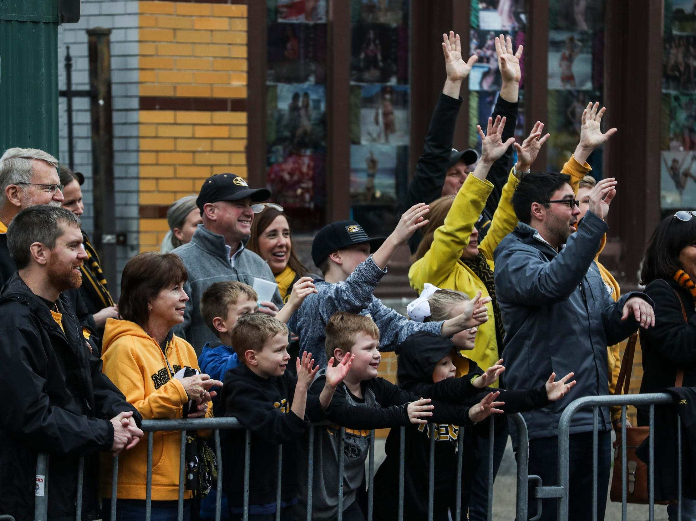December 30 2018 - Missouri fans reach out Scenes during the Annual Liberty Bowl Parade & Pep Rally on Sunday. On Monday the Oklahoma State Cowboys and Missouri Tigers play in the 2018 AutoZone Liberty Bowl.