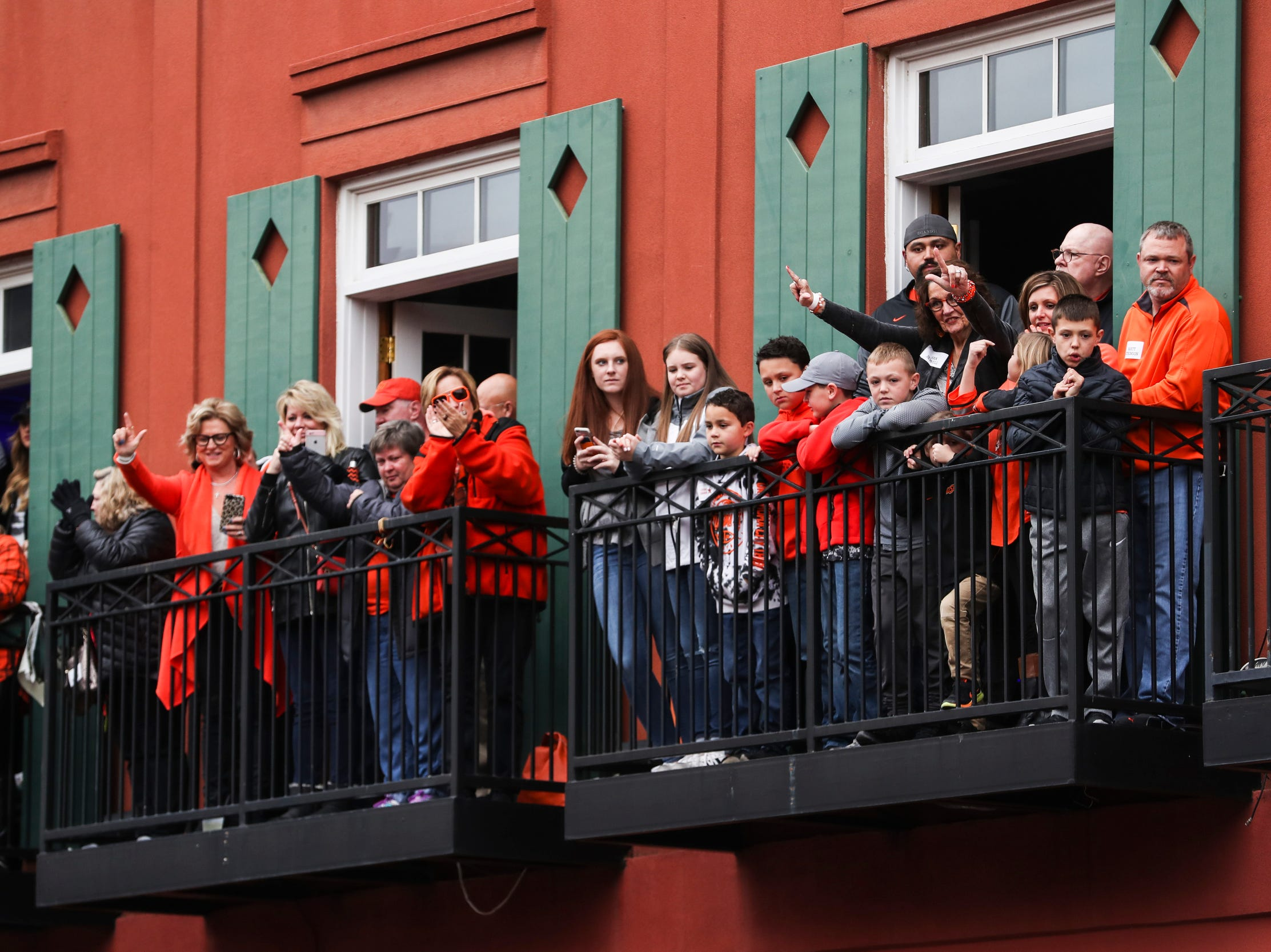 December 30 2018 - People watch from Jerry Lee Lewis' Cafe & Honky Tonk during the Annual Liberty Bowl Parade & Pep Rally on Sunday. On Monday the Oklahoma State Cowboys and Missouri Tigers play in the 2018 AutoZone Liberty Bowl.