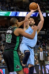 Memphis Grizzlies center Marc Gasol, right, shoots against Boston Celtics center Al Horford (42) during the first half of an NBA basketball game Saturday, Dec. 29, 2018, in Memphis, Tenn. (AP Photo/Brandon Dill)