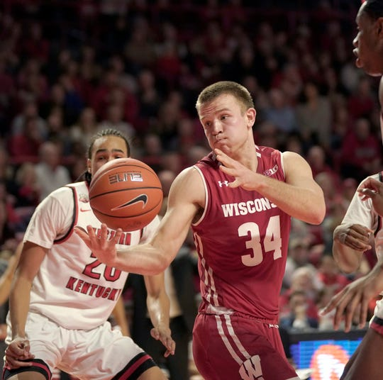 Wisconsin guard Brad Davison tries to hold onto the ball during the first half Saturday against Western Kentucky.