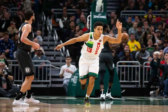 Milwaukee Bucks guard Malcolm Brogdon celebrates a basket.