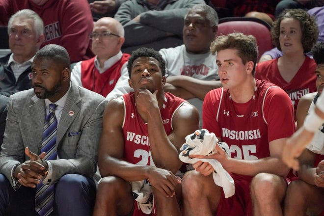 Wisconsin guard Khalil Iverson (21) and forward Nate Reuvers (35) look on during the closing moments of an NCAA college basketball game against Western Kentucky, Saturday, Dec. 29, 2018, in Bowling Green, Ky. (AP Photo/Tim Broekema)