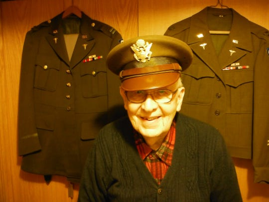 Eugene Nordby, 100, volunteered for the U.S. Army after graduating from UW-Madison Medical School in 1943. He was honored before Sunday's Packers game.
