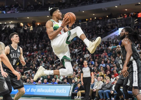 Milwaukee Bucks forward Giannis Antetokounmpo glides to the basket in the fourth quarter during the game against the Brooklyn Nets at Fiserv Forum.