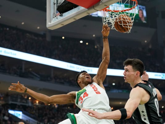 bucks let threes fly giannis nets triple double in win over brooklyn