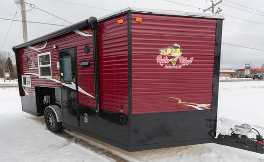 A 17-foot Rustic Retreat Edition Ice Castle fish house is seen at Lakewood Trailers in Lakewood. The $24,515 trailer has similar features to a traditional travel trailer except that it comes with six fishing holes in the floor and can be lowered so the chassis is flush with the ice.