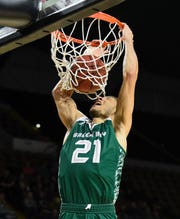UW-Green Bay guard Kameron Hankerson scores on a breakaway dunk against UW-Milwaukee.