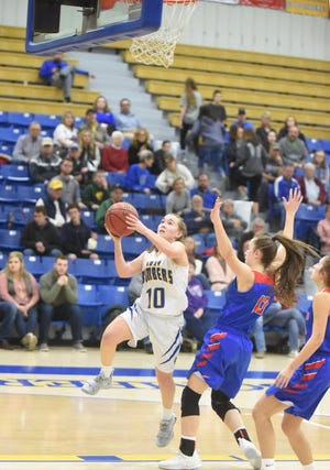 Mountain Home's Payton Huskey goes up for two against Paragould on Saturday night.