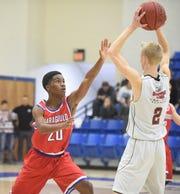 Paragould freshman Marcellus Williams defends Mountain Home Christian Academy's Caleb Bingham.