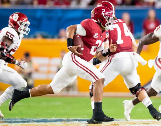 Alabama quarterback Jalen Hurts (2) carries the ball in first half action of the Orange Bowl at Hard Rock Stadium in Miami Gardens, Fla., on Saturday December 29, 2018.