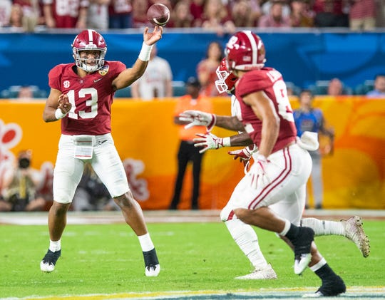 Alabama quarterback Tua Tagovailoa (13) passes to Alabama tight end Irv Smith Jr. (82) in second half action of the Orange Bowl at Hard Rock Stadium in Miami Gardens, Fla., on Saturday December 29, 2018.