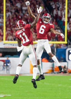 Alabama wide receivers Henry Ruggs, III, (11) and DeVonta Smith (6) celebrate Ruggs' touchdown catch in first half action of the Orange Bowl at Hard Rock Stadium in Miami Gardens, Fla., on Saturday December 29, 2018.