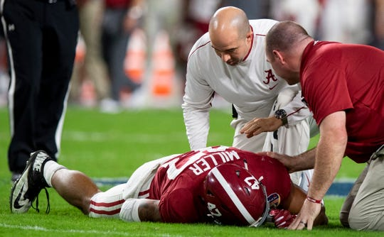 Alabama linebacker Christian Miller (47) is injured during second half action of the Orange Bowl at Hard Rock Stadium in Miami Gardens, Fla., on Saturday December 29, 2018.
