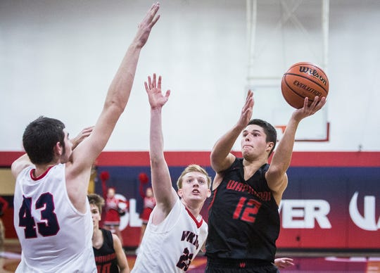 Wapahani's Drew Luce tries to finish in traffic during the team's win over Blue River.