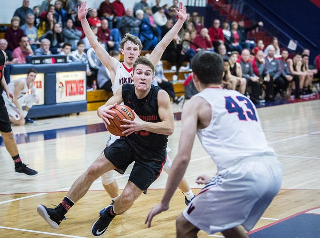 Wapahani's Garett Stanley gathers himself in the lane during a win over Blue River.