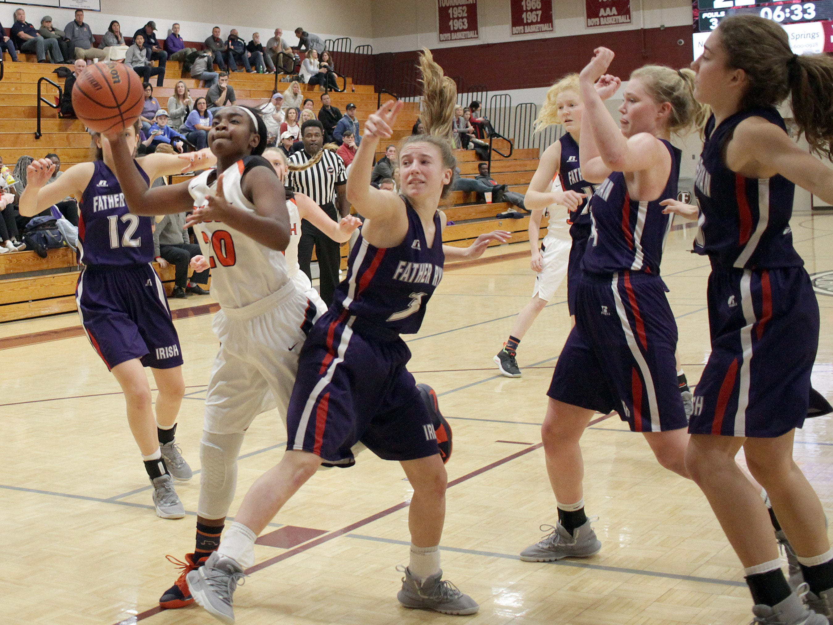 Beech's Deshiya Hoosier drives through the Father Ryan defense on Saturday, December 29, 2018.