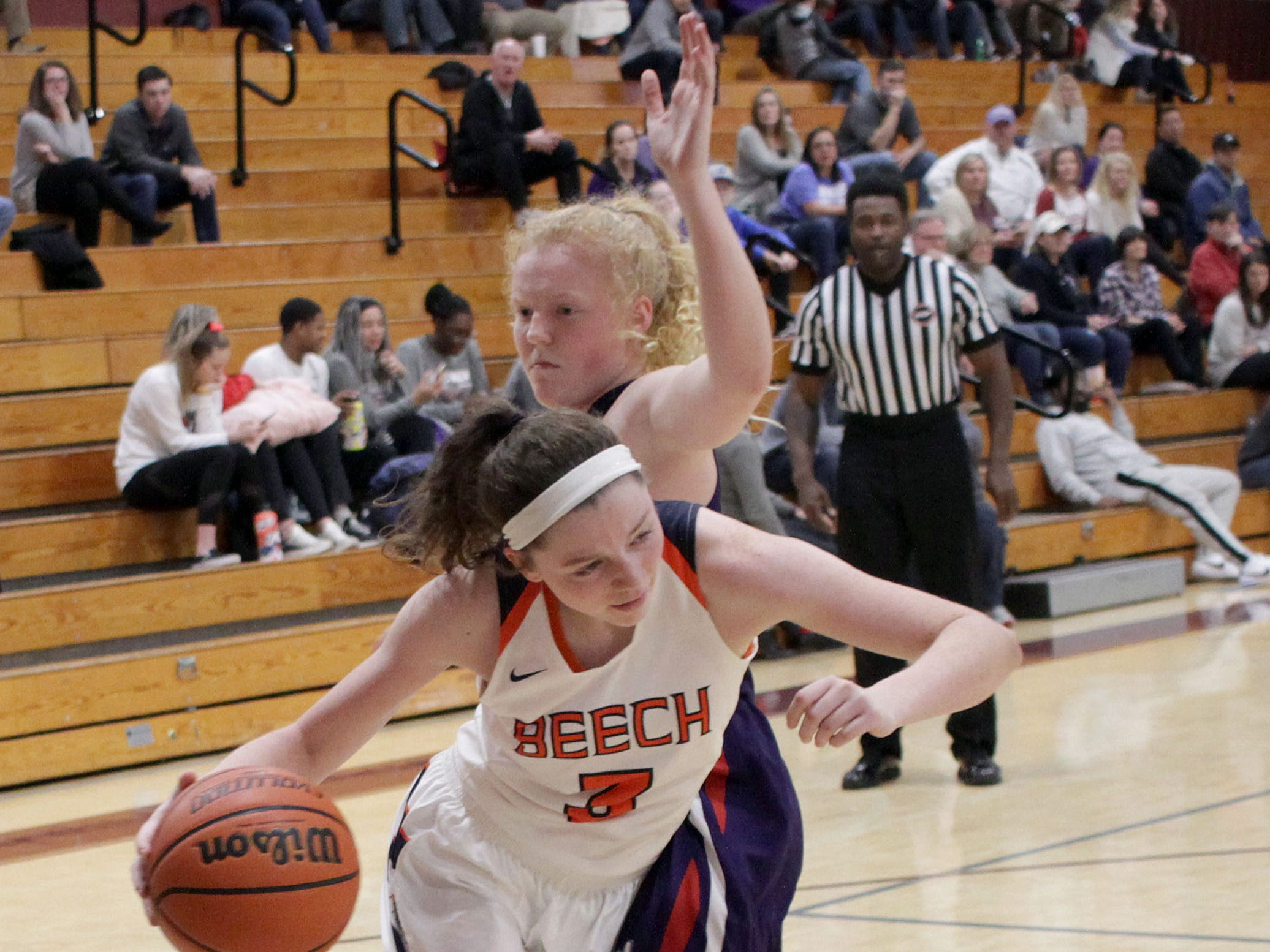 Beech's Jana Claire Swafford drives around Father Ryan's Maddie Dooling on Saturday, December 29, 2018.