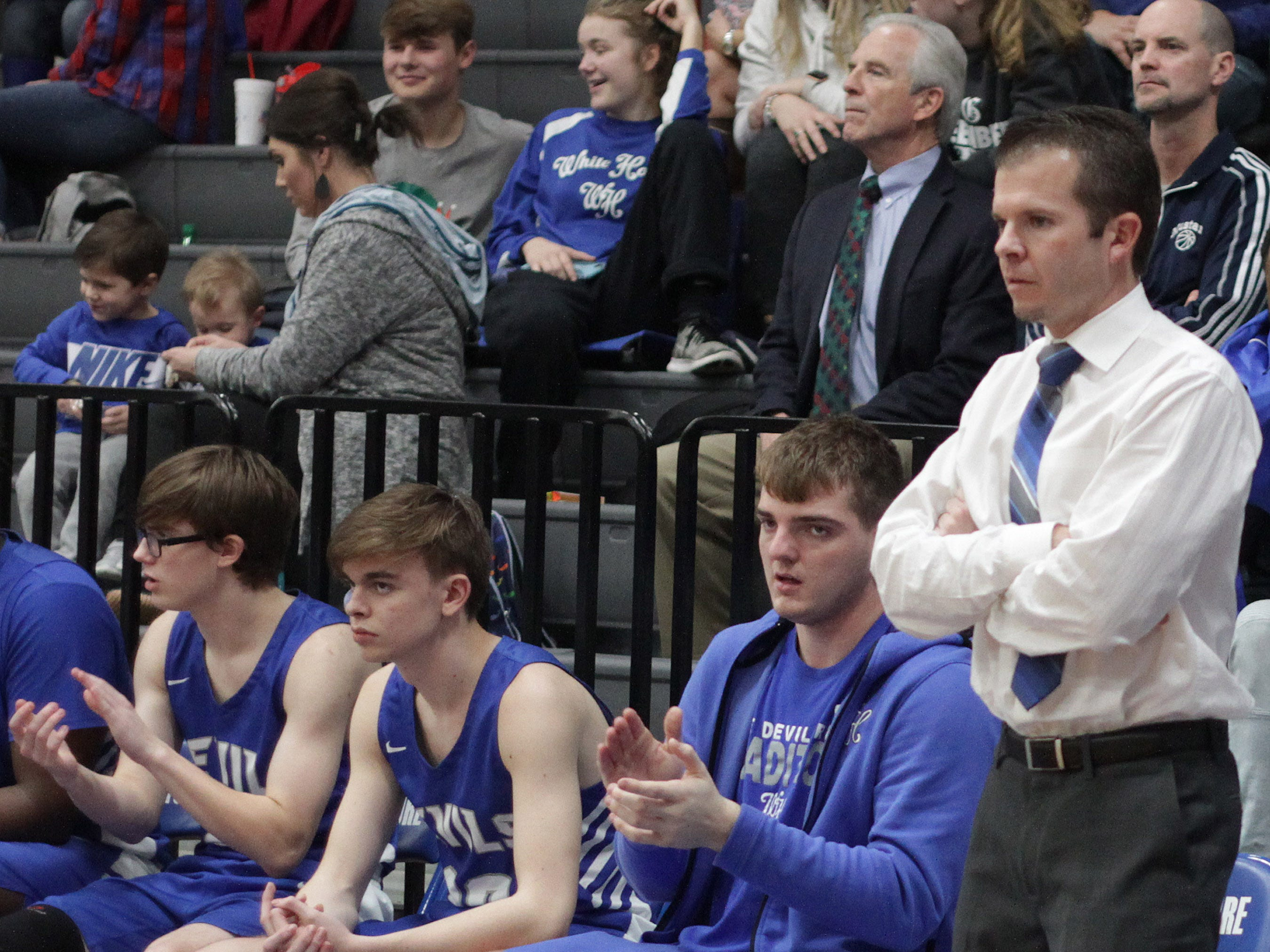White House coach Caleb Cook watches his team take on Pope John Paul II on Thursday, December 27, 2018.