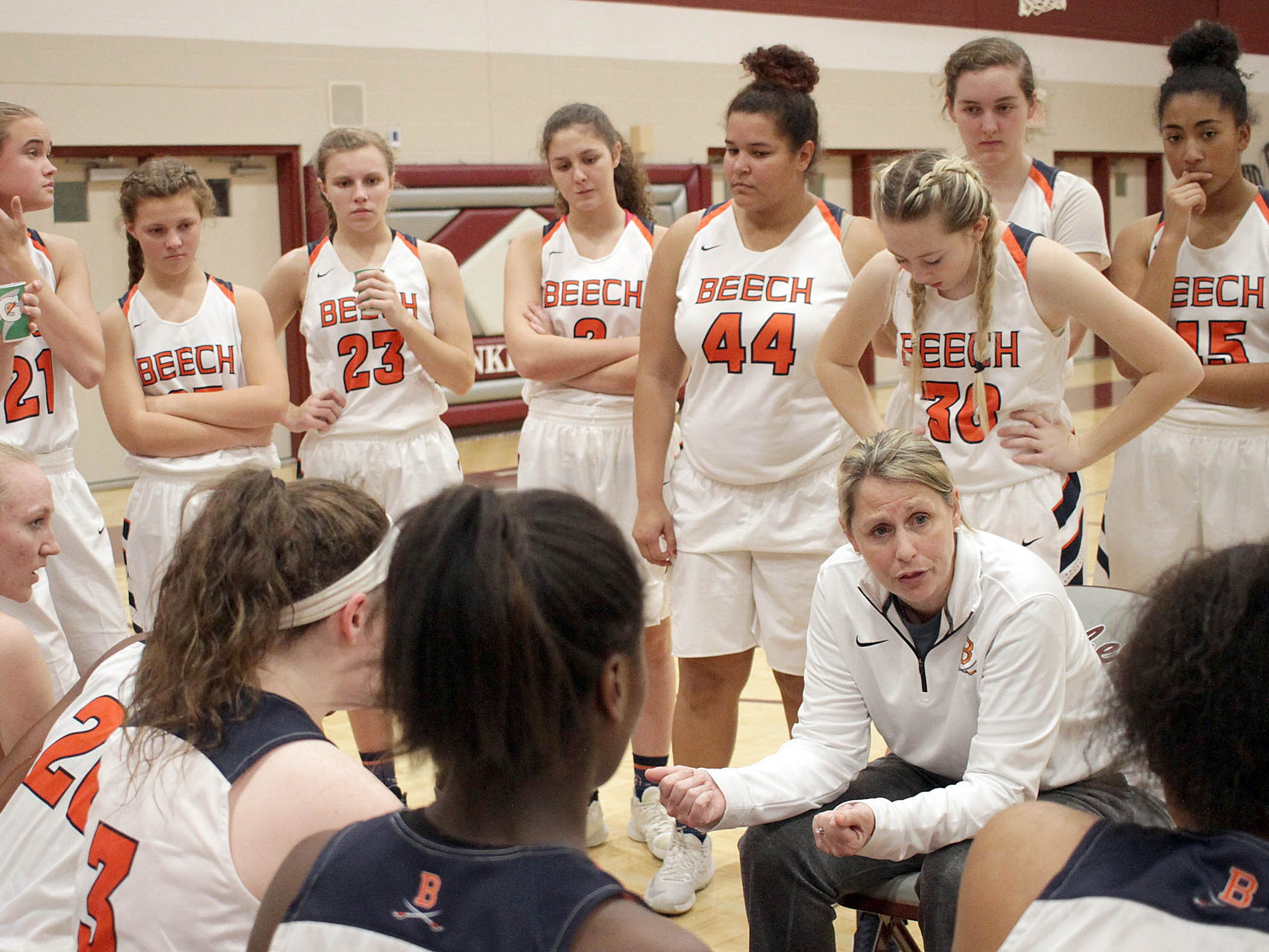 Beech Coach Kristi Utley has a talk with her team as they play Father Ryan on Saturday, December 29, 2018.