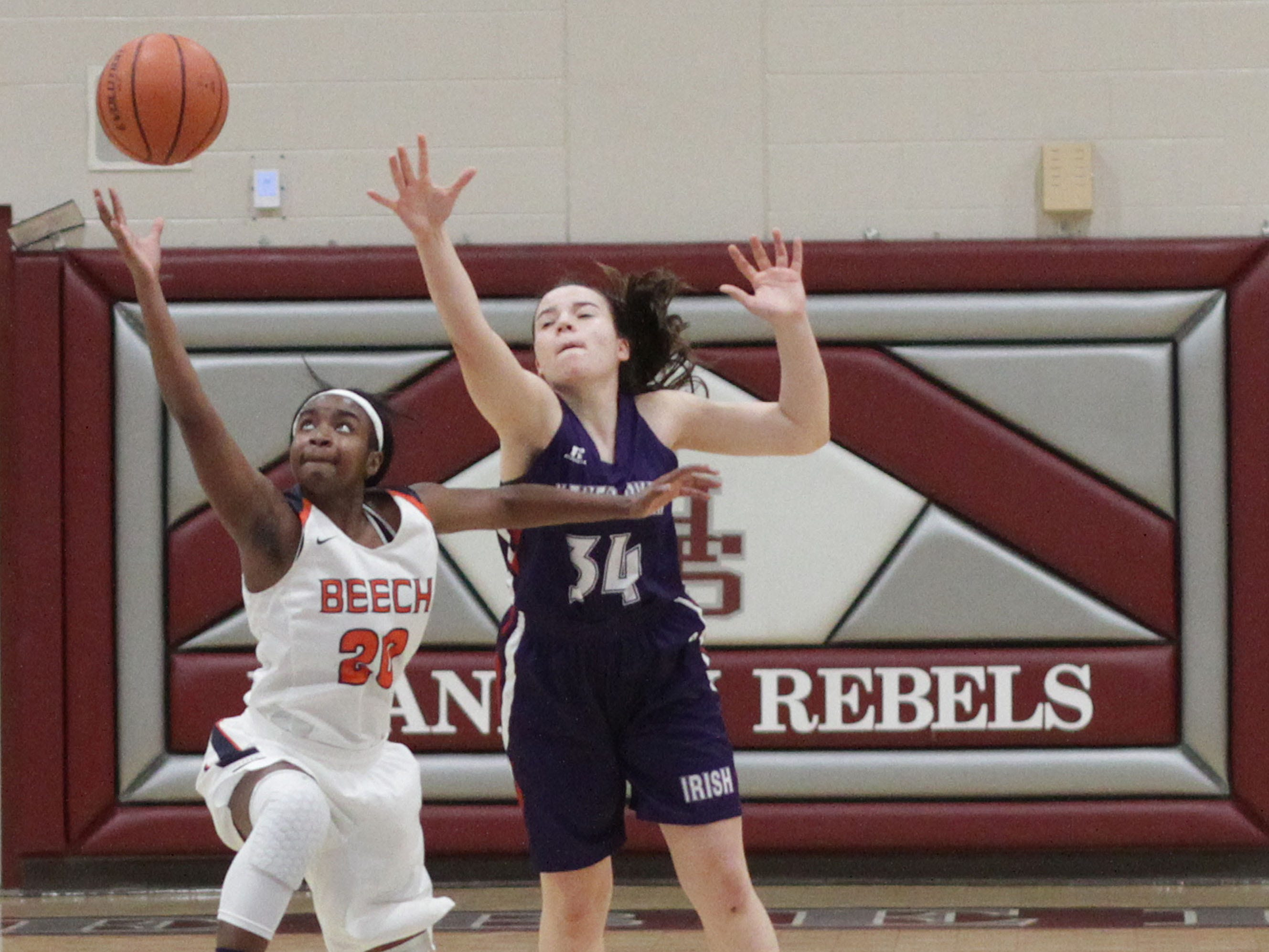 Beech's Deshiya Hoosier breaks up a pass to Father Ryan's Mary Mackie on Saturday, December 29, 2018.