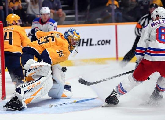Nashville Predators goaltender Pekka Rinne (35) makes a save on a rebound attempt by New York Rangers left wing Cody McLeod (8) during the second period at Bridgestone Arena in Nashville, Tenn. on Dec. 29, 2018.