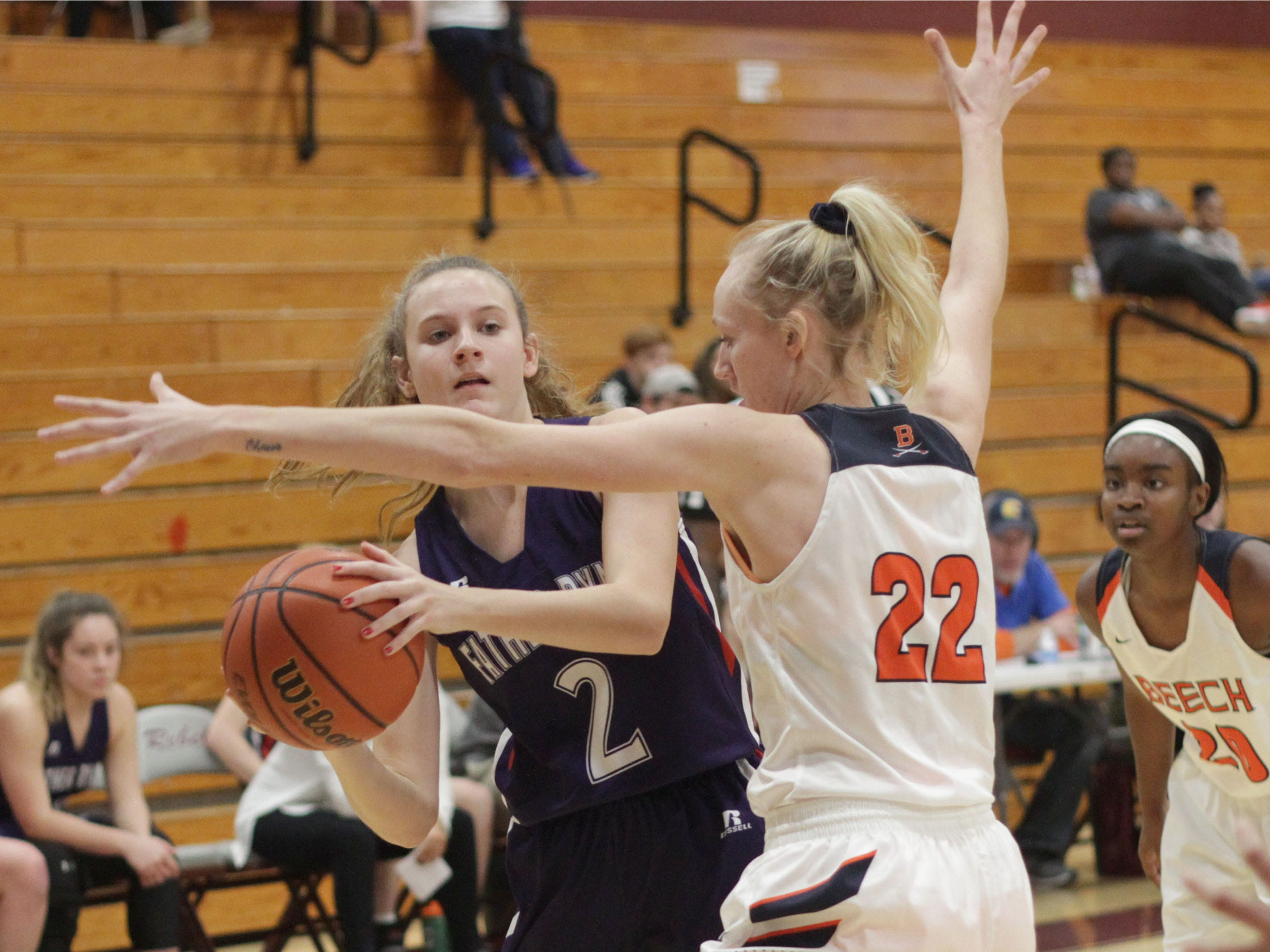 Father Ryan's Sydnee Clunan is guarded tightly by Beech's Kendra Mueller on Saturday, December 29, 2018.