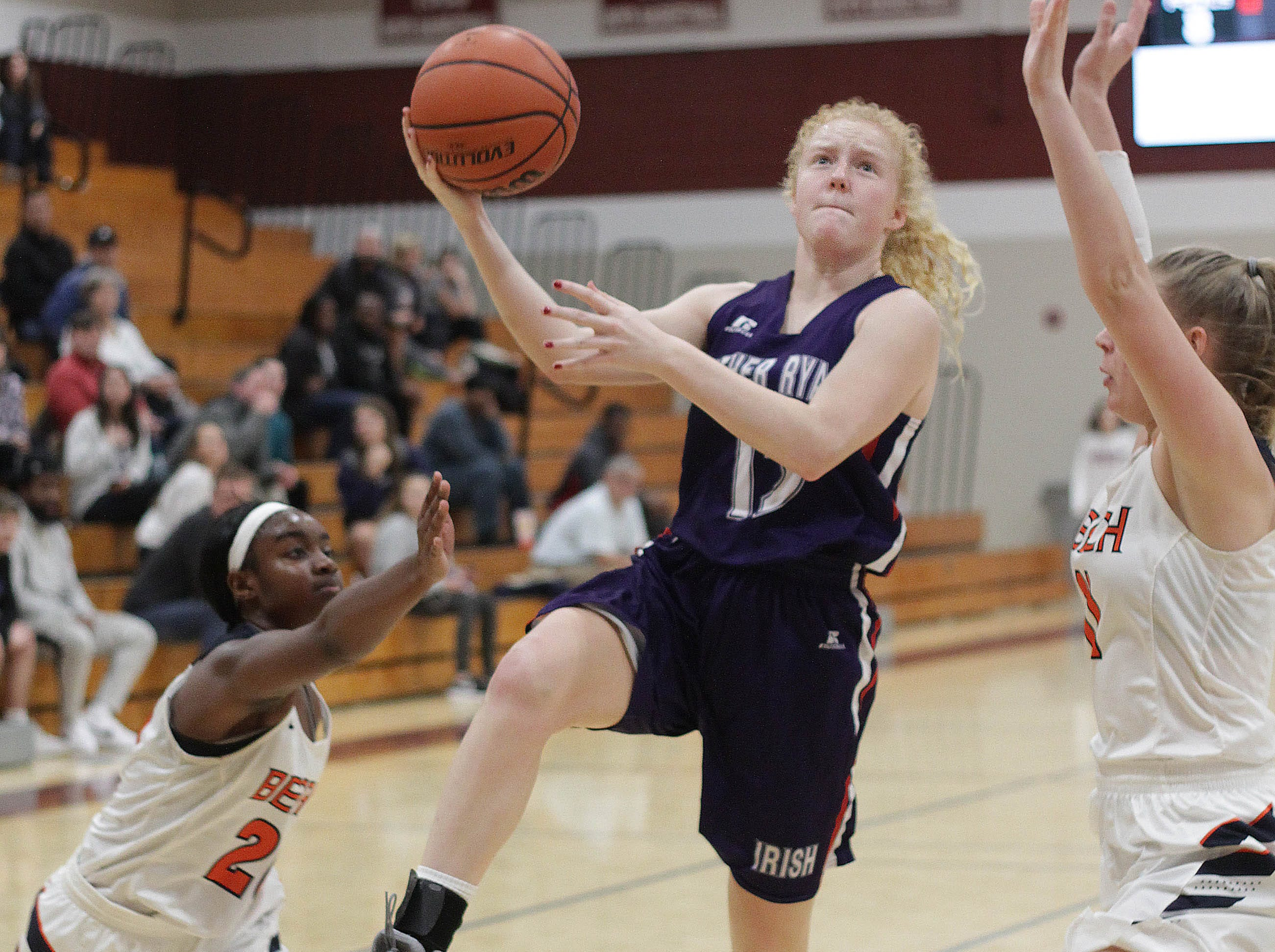 Father Ryan's Maddie Dooling drives the lane against Beech on Saturday, December 29, 2018.