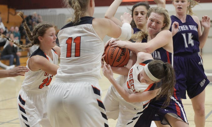 Beech's Jana Claire Swafford has the ball while Father Ryan's Page Graham tries to rip it away on Saturday, December 29, 2018.