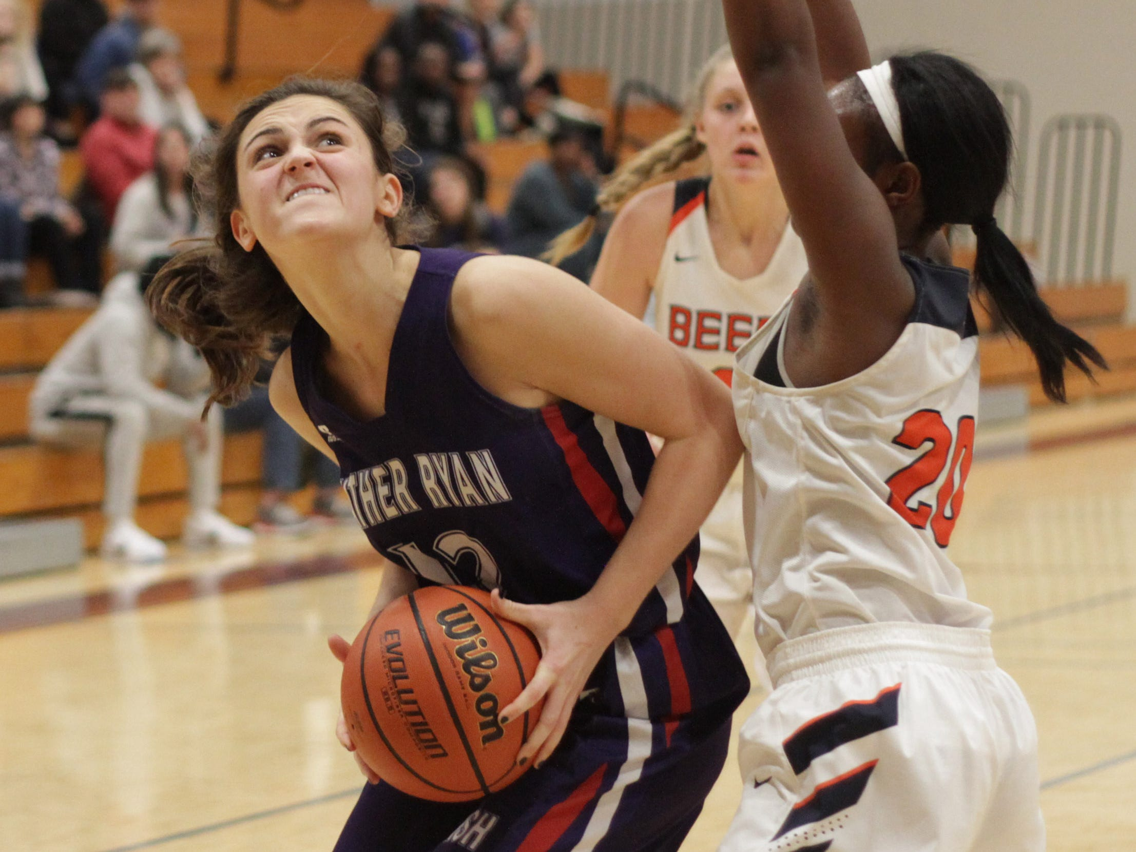 Father Ryan's Camille Knoll looks for room to shoot while guarded by Beech's Deshiya Hoosier on Saturday, December 29, 2018.