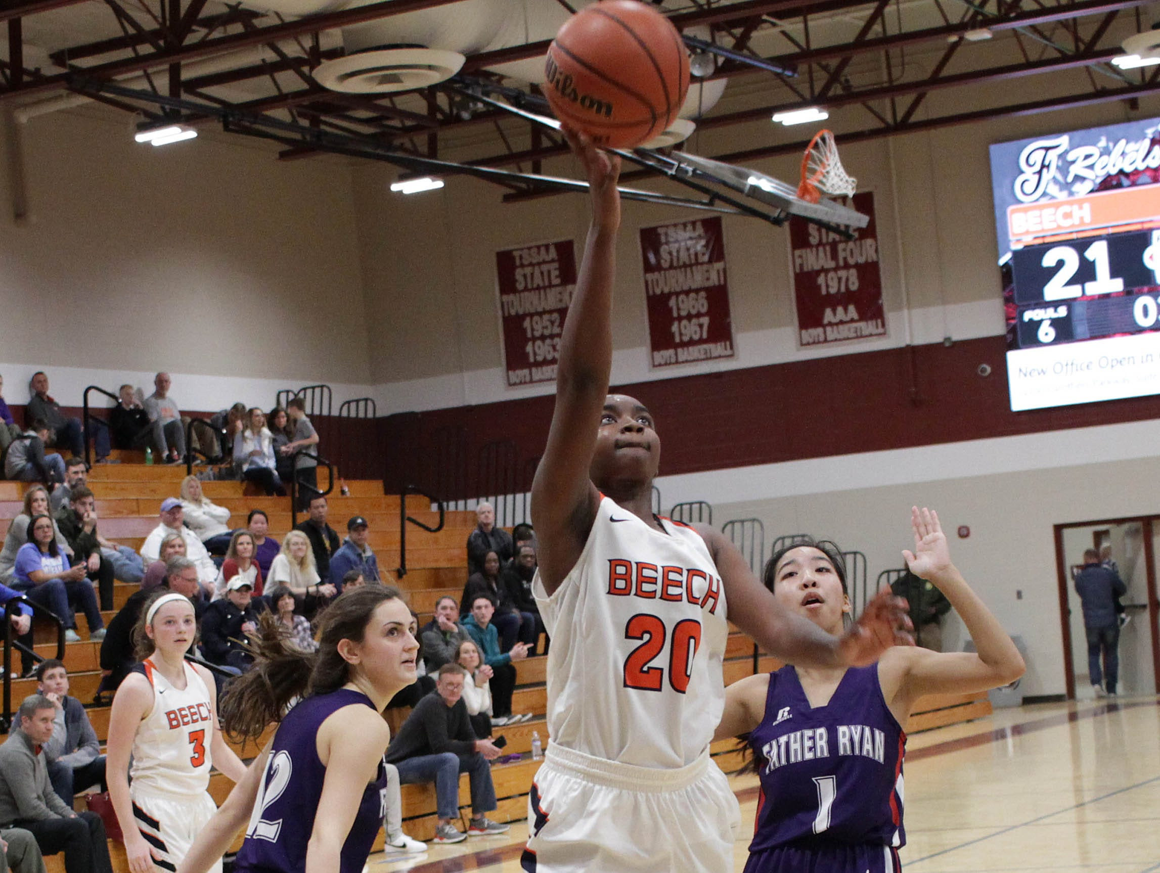 Beech's Deshiya Hoosier drives to the hoop against Father Ryan on Saturday, December 29, 2018.