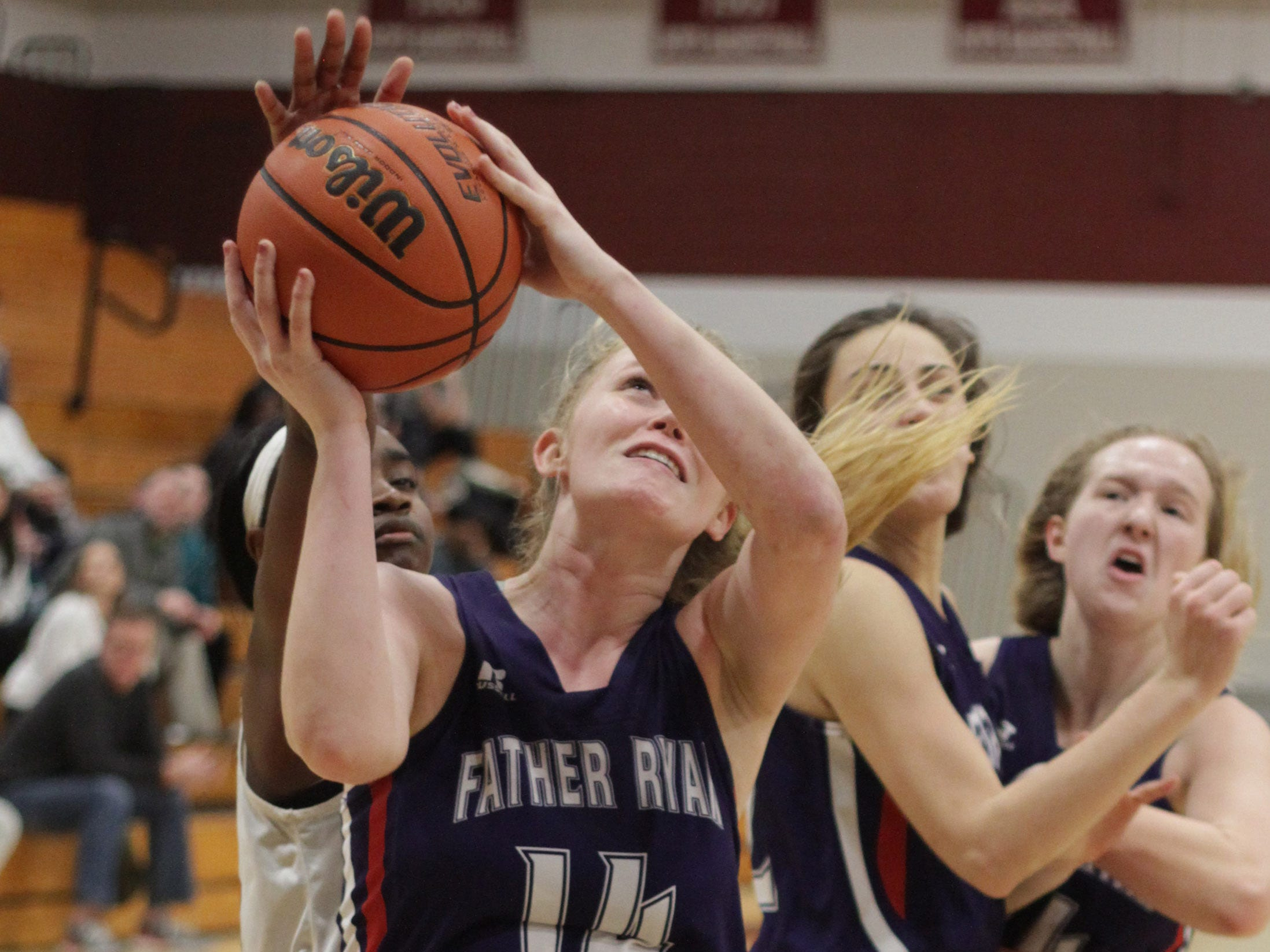 Father Ryans's Bree Thibeault shoots as Beech's Deshiya Hoosier reaches in from behind on Saturday, December 29, 2018.