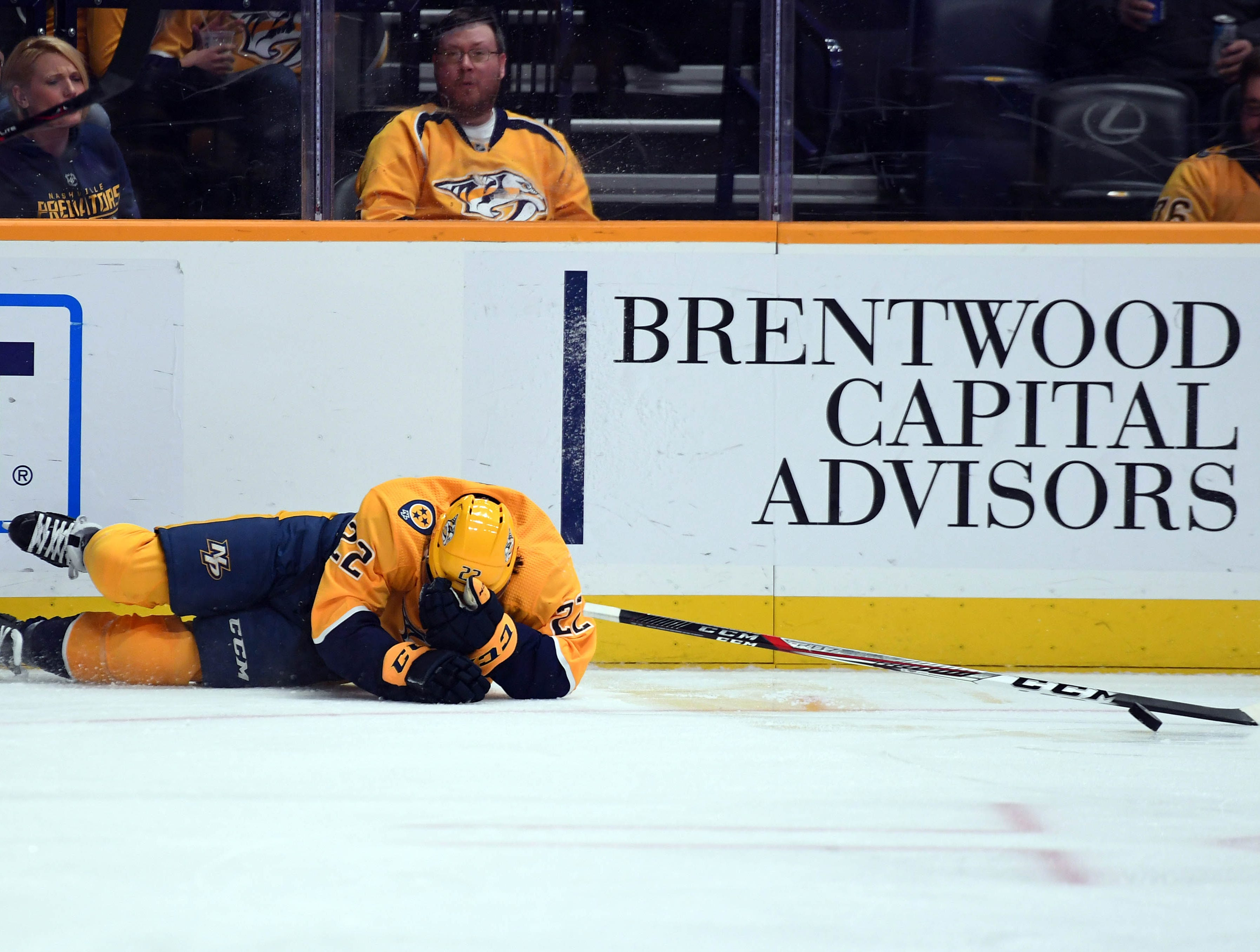 Nashville Predators left wing Kevin Fiala (22) holds his head after crashing into the boards during the first period against the New York Rangers at Bridgestone Arena in Nashville, Tenn. on Dec. 29, 2018.