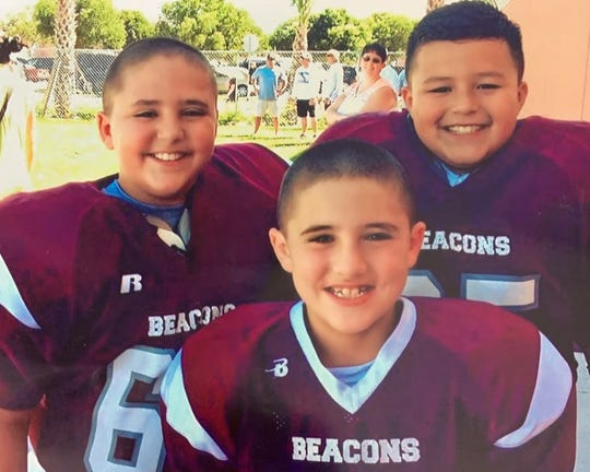 Jacob Allen, top right, before a youth football game in the First Baptist Beacons program circa 2010.