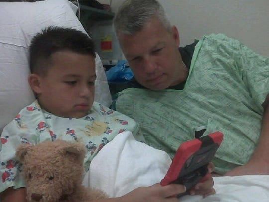 Jacob Allen with his dad, Chris, during one of his many hospital stays as a kid. Jacob was born prematurely and had a series of medical issues until he was 10 as a result.