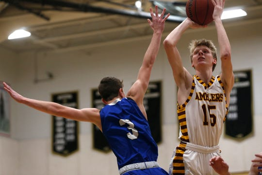Loyola's Bennett Kwiecinski attempts a jump shot against Covington Catholic during the Kelleher Firm Gulfshore Holiday Hoopfest championship game at Golden Gate High School on Sunday.