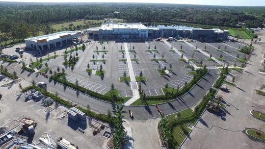 Sprouts Farmers Market, center, will open Feb. 20, 2019, to anchor Logan Landings retail center under construction on the southeast corner of Logan Boulevard and Immokalee Road in North Naples.