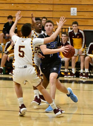 Community School of Naples' Jacob Siegel (1) drives the ball with Loyola Academy's William Pujals trying to defend during the Kelleher Firm Gulfshore Holiday Hoopfest on Saturday.