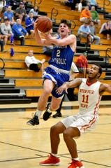 Deerfield Beach High School's Michael Johnson (11) watches as Covington Catholic's Grant Kisken (2) takes the ball to the basket on a fast break during the Kelleher Firm Gulfshore Holiday Hoopfest on Saturday, Dec. 29, 2018.