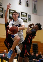 Community School of Naples' Jacob Siegel attempts to score against Deerfield Beach during the Kelleher Firm Gulfshore Holiday Hoopfest third-place game at Golden Gate High School on Sunday.