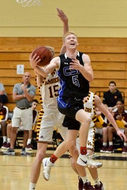 Community School of Naples' Parker Weiss (5) take the ball to the rim in their game with Loyola Academy during the Kelleher Firm Gulfshore Holiday Hoopfest on Saturday, Dec. 29, 2018.