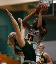 Miami Country Day School's Koi Love shoots the ball over Beaver Dam's Paige Schumann during the American Division championship game at the Naples Holiday Shootout, Saturday, Dec. 29, 2018 at Gulf Coast High School in Naples.