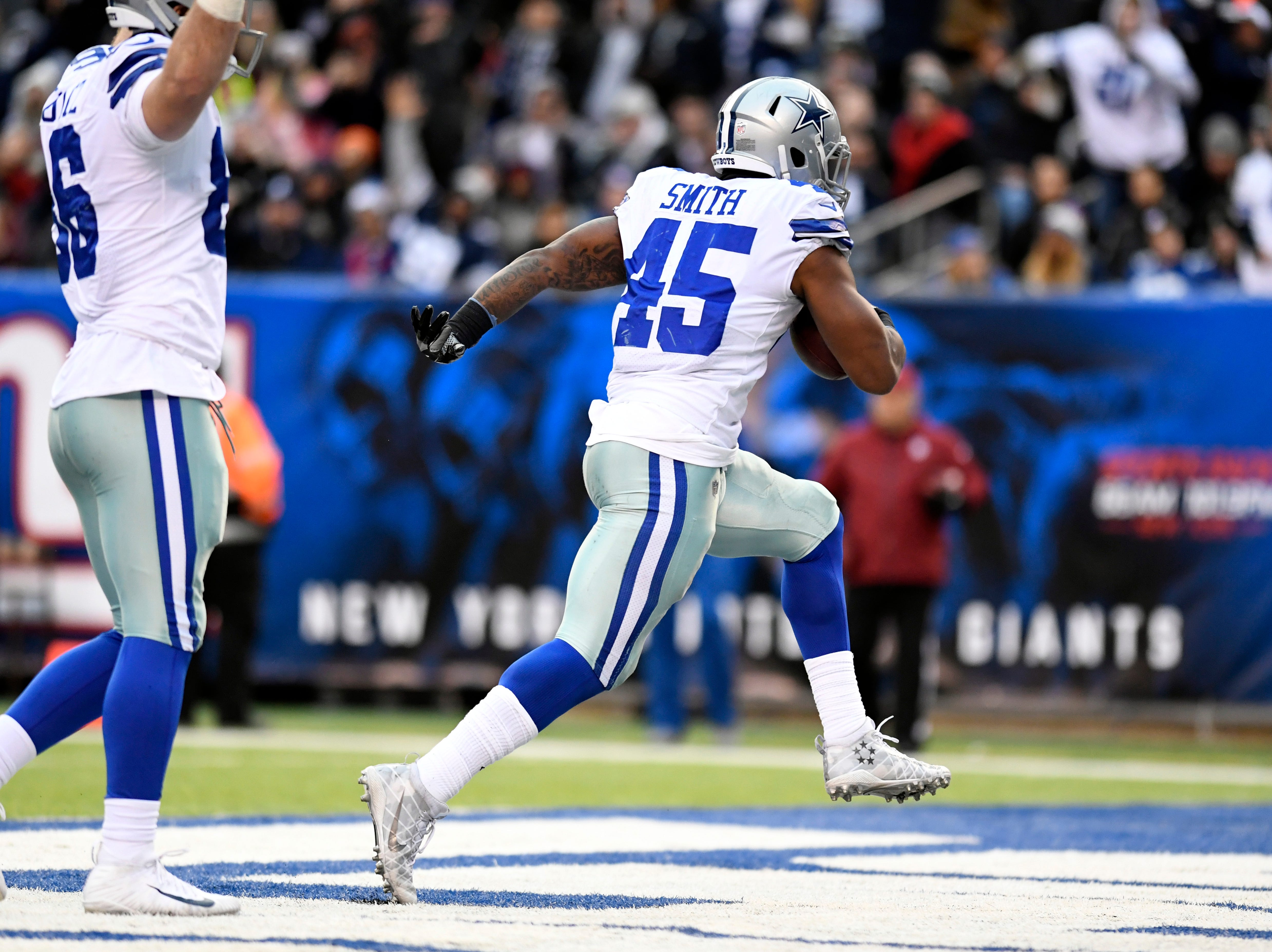 Dallas Cowboys running back Rod Smith (45) scores on a one-yard-run in the fourth quarter. The New York Giants lose to the Dallas Cowboys 36-35 on Sunday, Dec. 30, 2018, in East Rutherford.