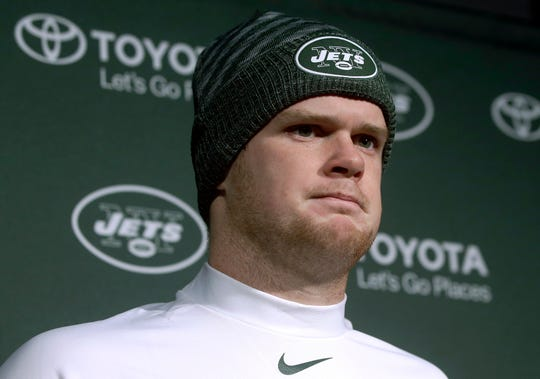 New York Jets quarterback Sam Darnold speaks to the media following an NFL football game against the New England Patriots, Sunday, Dec. 30, 2018, in Foxborough, Mass. (AP Photo/Steven Senne)
