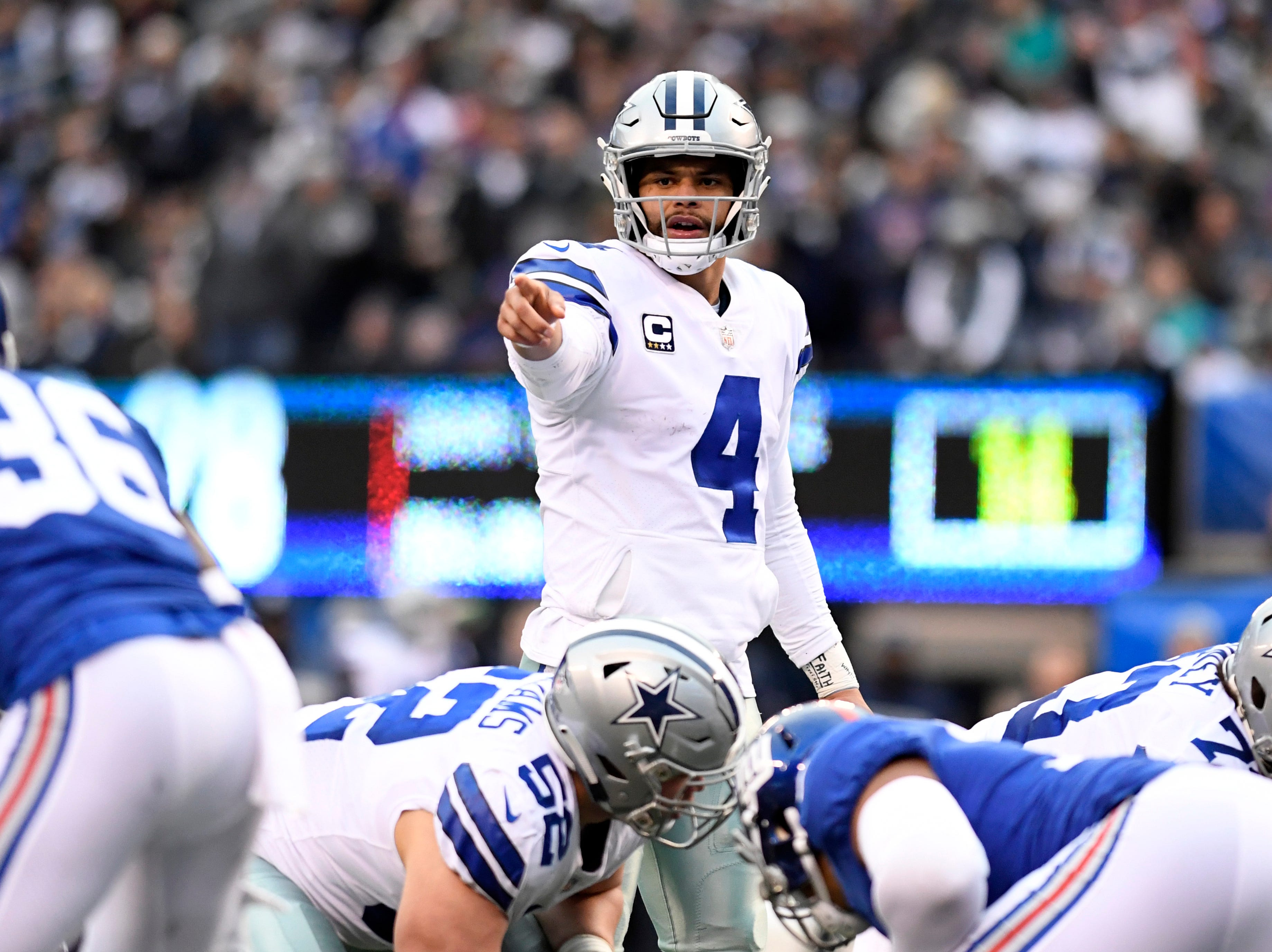 Dallas Cowboys quarterback Dak Prescott (4) at the line of scrimmage in the fourth quarter. The New York Giants lose to the Dallas Cowboys 36-35 on Sunday, Dec. 30, 2018, in East Rutherford.