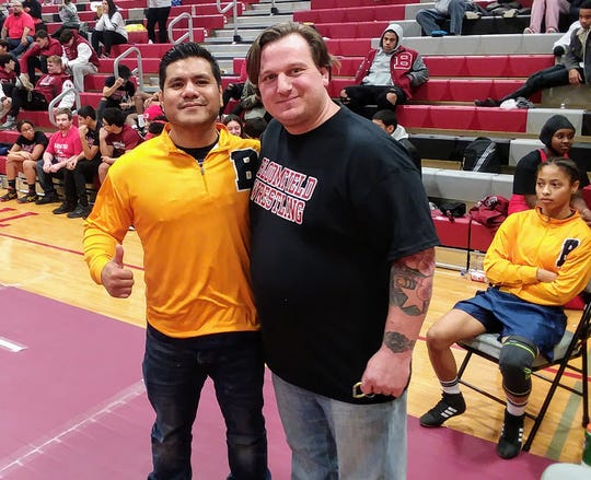 Belleville assistant Jay Isip (left) and Bloomfield coach Ryan Smircich during the tournament.