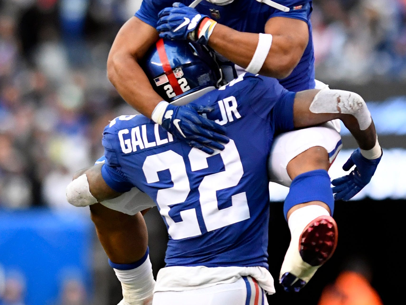 New York Giants running back Saquon Barkley jumps on Wayne Gallman (22) after Gallman's touchdown in the fourth quarter. The New York Giants lose to the Dallas Cowboys 36-35 on Sunday, Dec. 30, 2018, in East Rutherford.