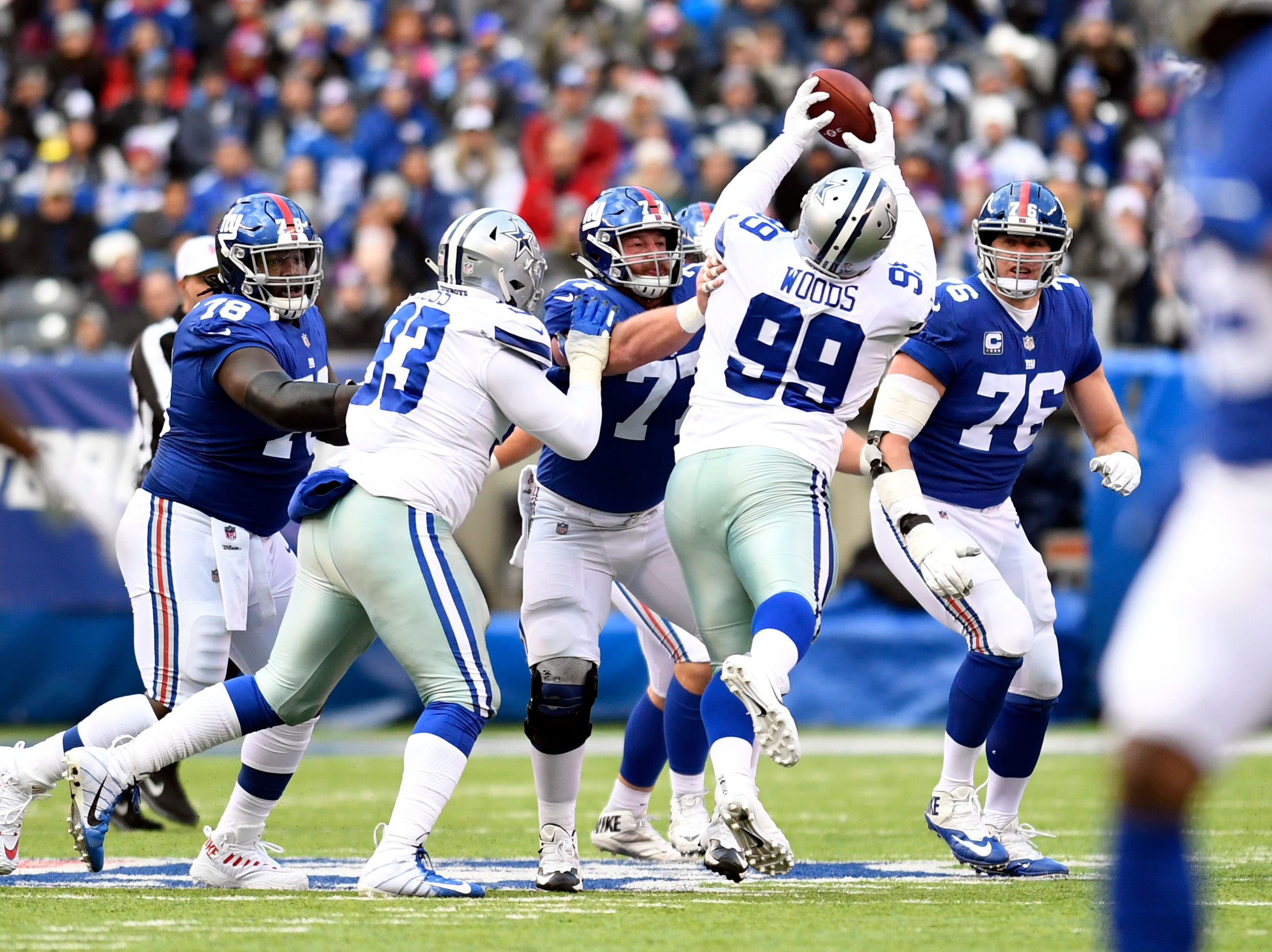 Dallas Cowboys defensive tackle Antwaun Woods (99) intercepts a pass throw by New York Giants quarterback Eli Manning (not pictured) in the first half. The New York Giants face the Dallas Cowboys in the last regular season game on Sunday, Dec. 30, 2018, in East Rutherford.